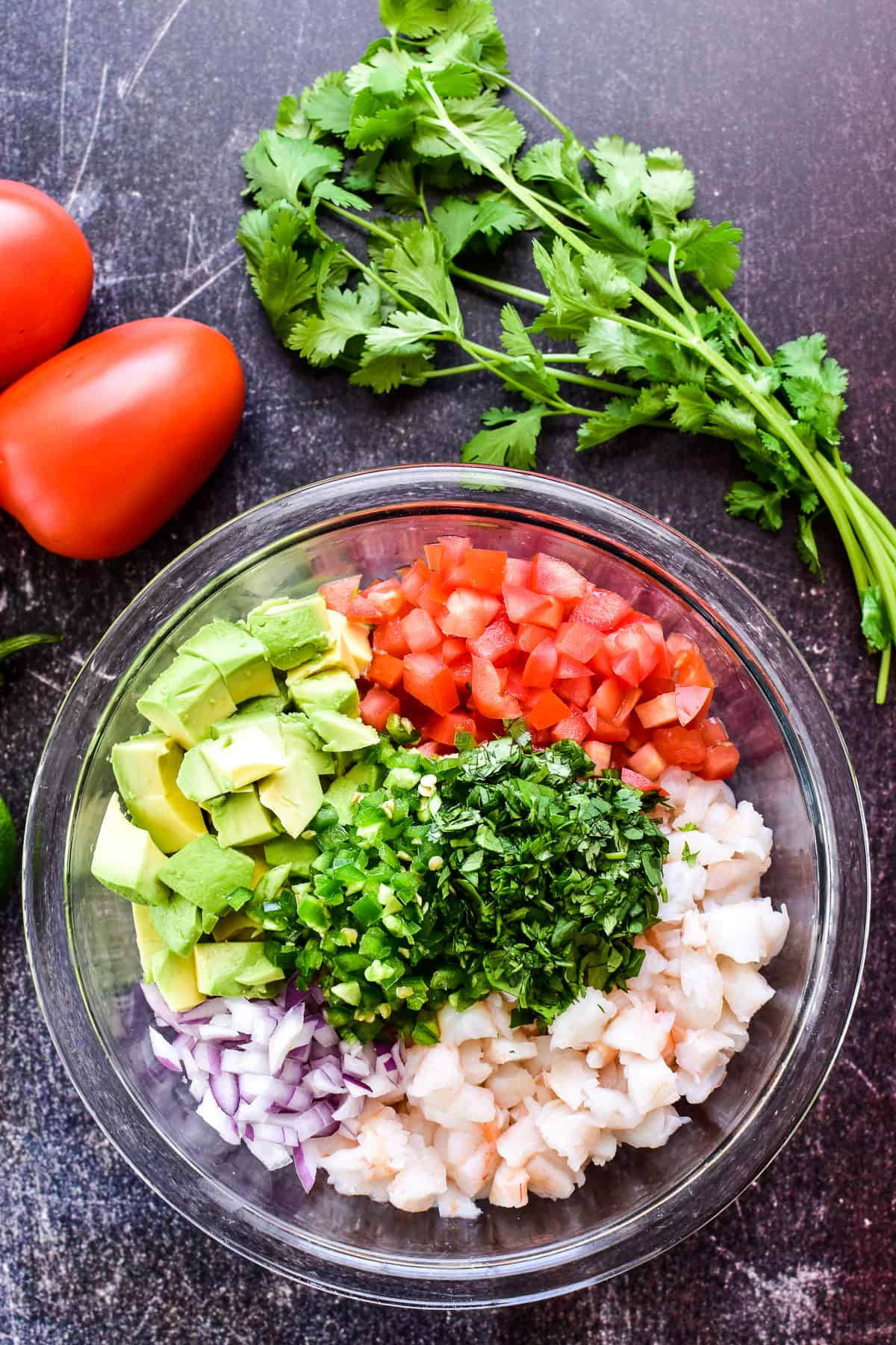Shrimp Ceviche ingredients chopped and separated in a mixing bowl