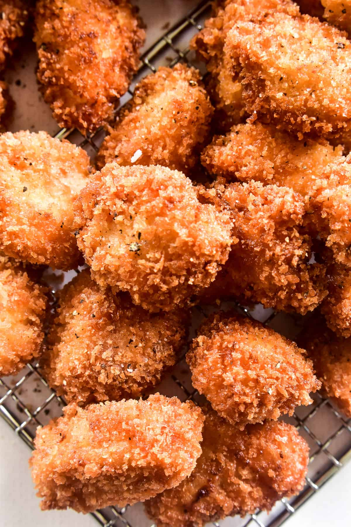 Close up of Crispy Chicken Nuggets on a wire rack