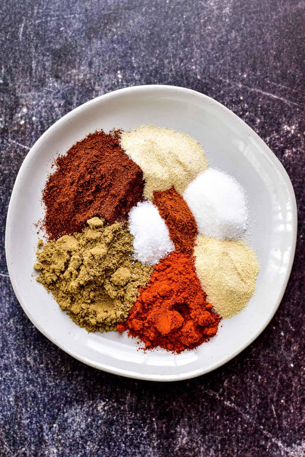 Overhead photo of Fajita Seasoning spices on a white plate