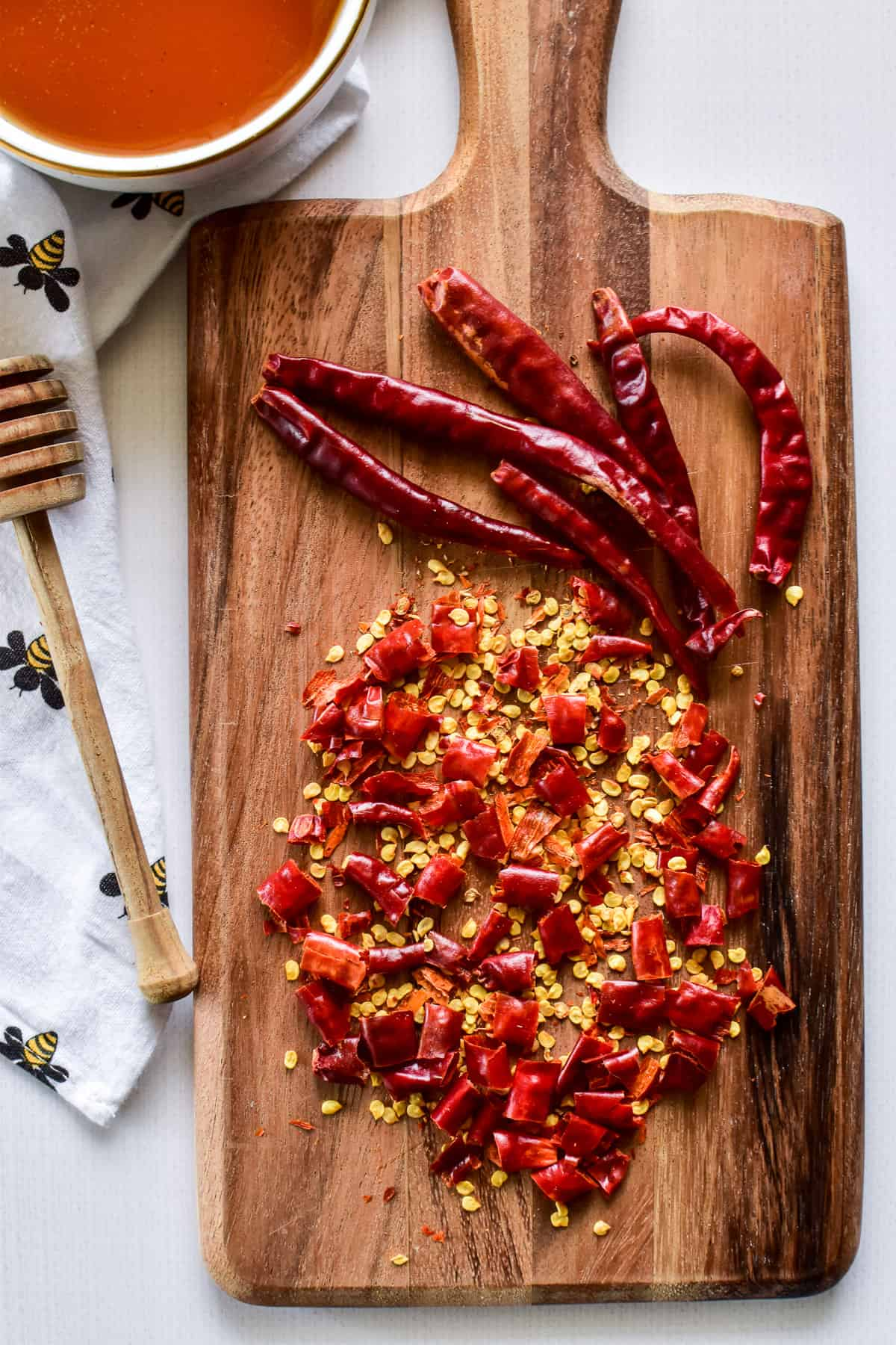 Chopped chili peppers on a wooden cutting board
