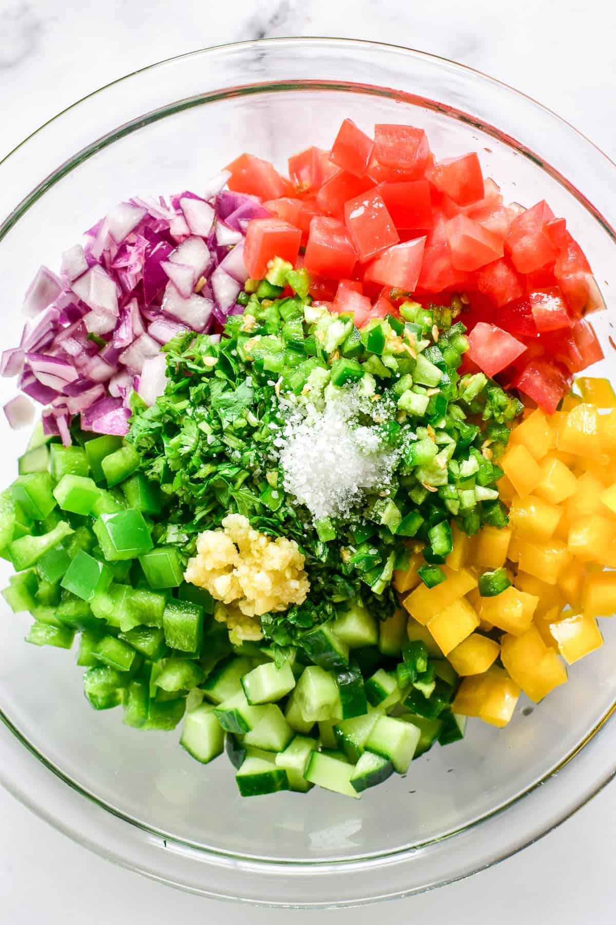 Cucumber Salsa ingredients in a mixing bowl