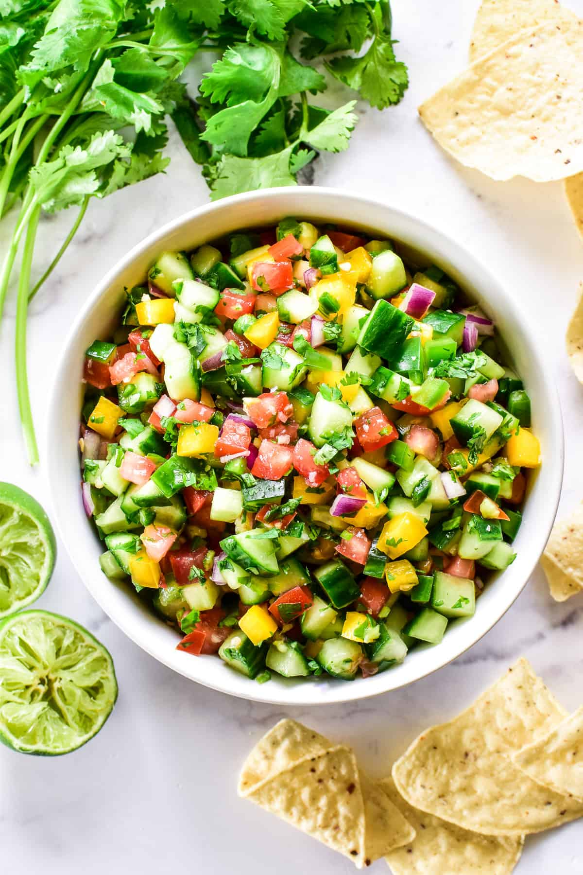 Overhead image of Cucumber Salsa in a white bowl