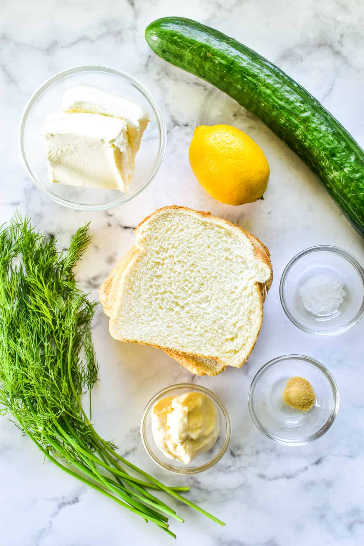 Cucumber Sandwich ingredients on a marble board