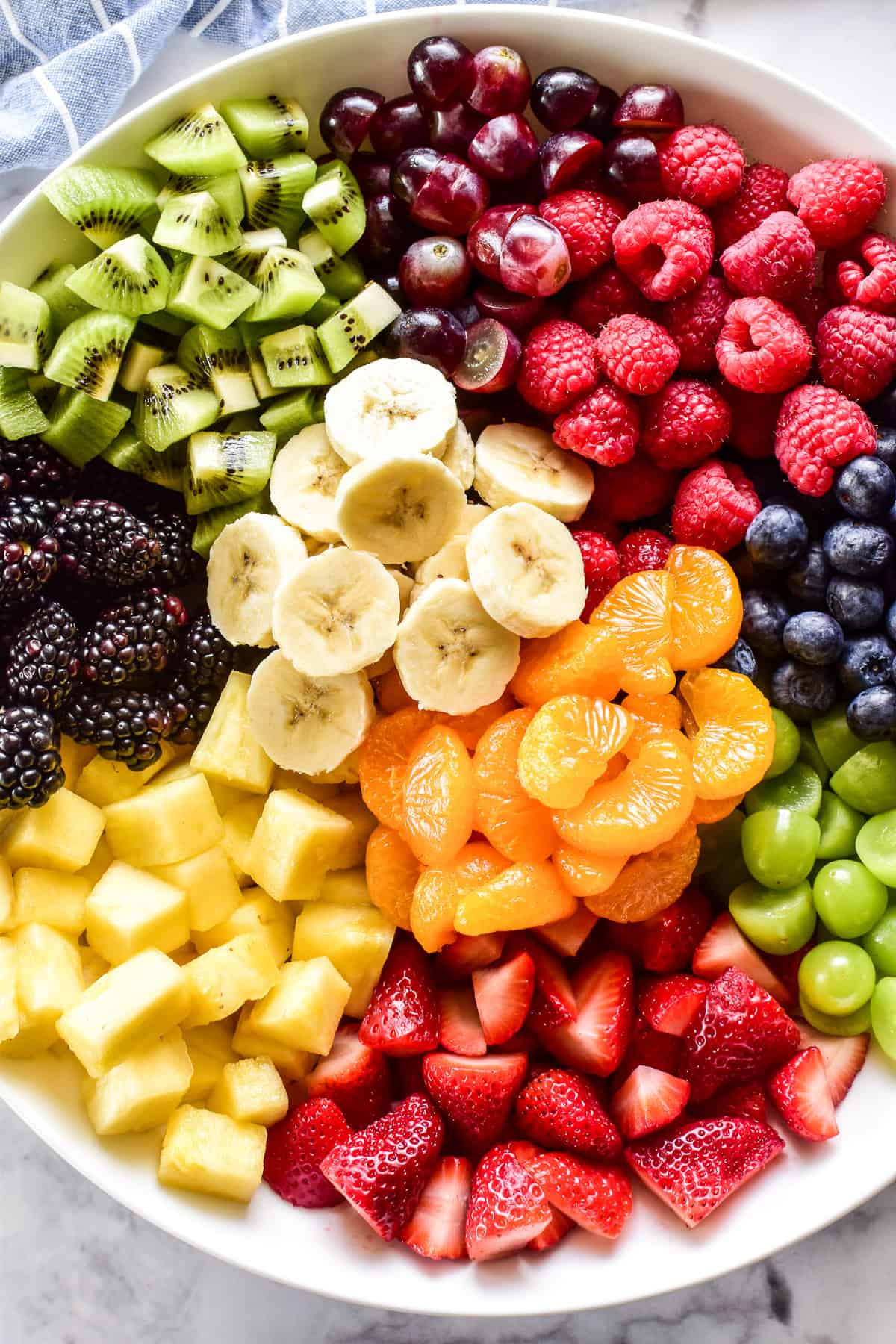Close up of Fruit Salad ingredients in a white bowl
