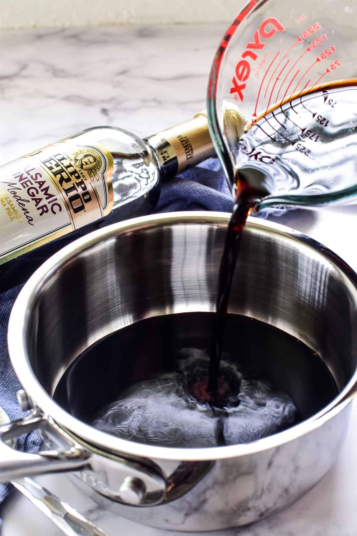 Pouring vinegar into a saucepan