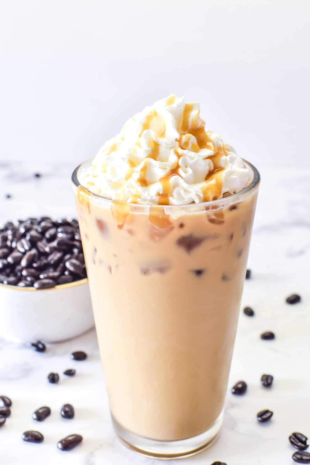 Close up of Iced Latte with whipped cream and caramel