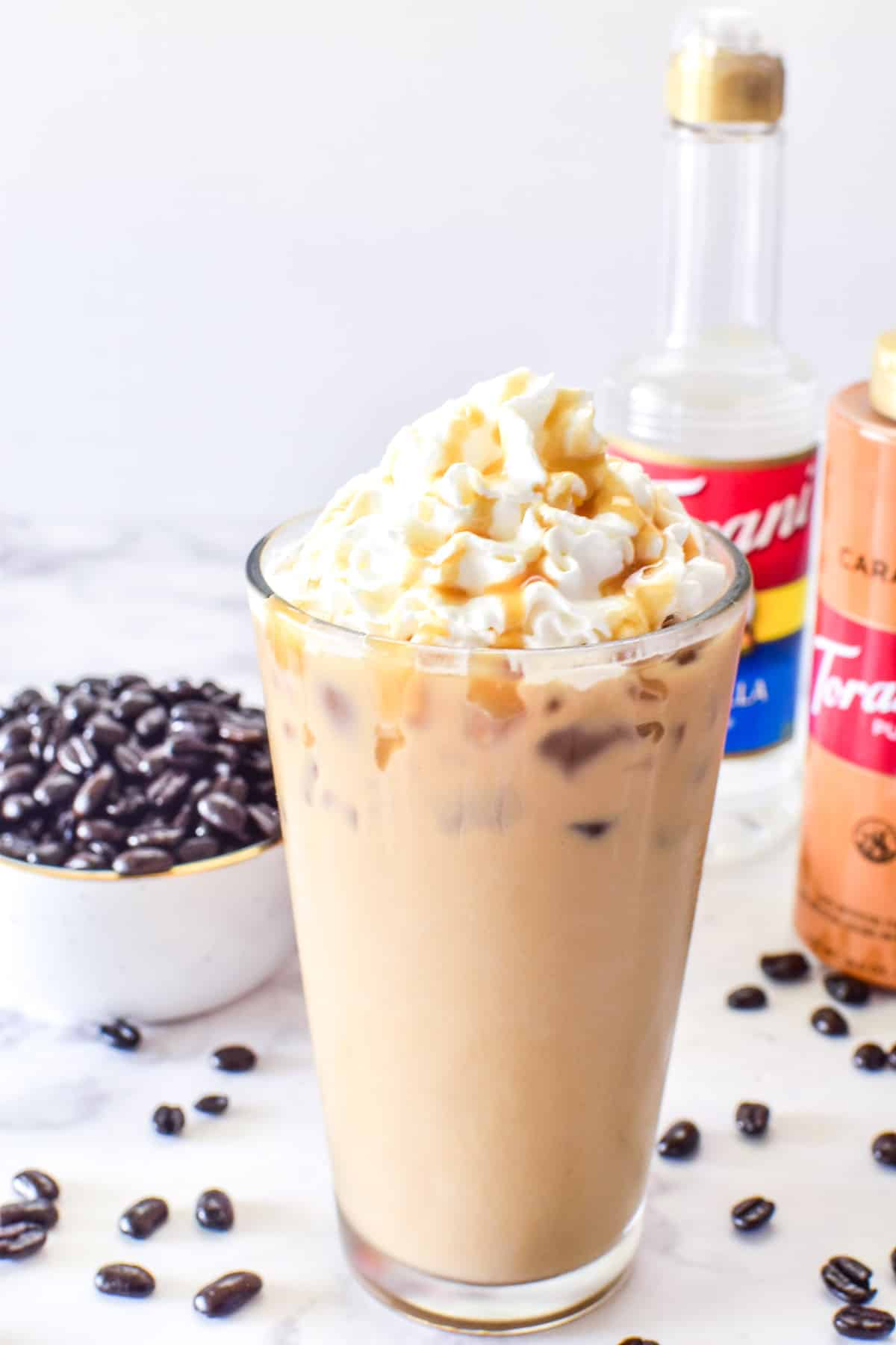 Iced Vanilla Latte with whipped cream and caramel syrup
