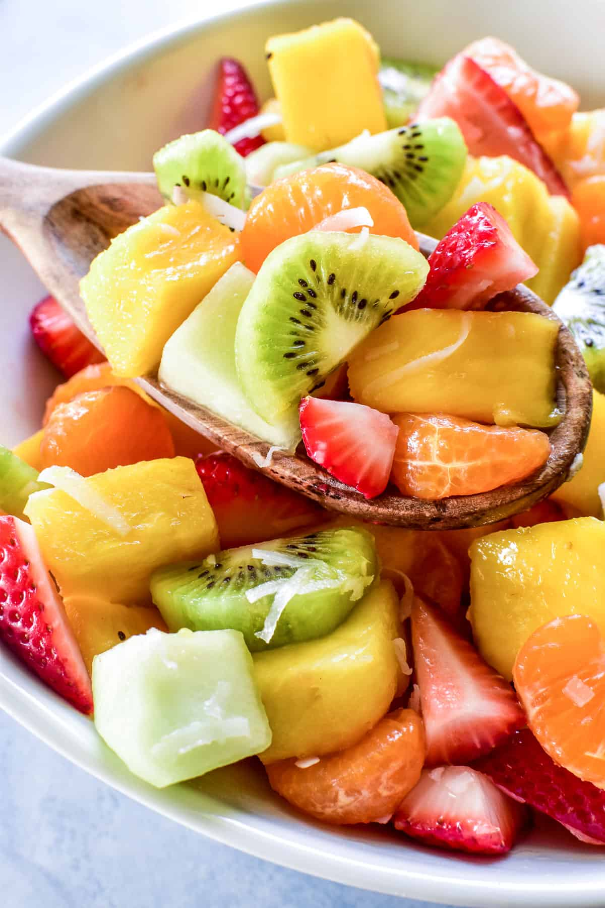 Tropical Fruit Salad served with a wooden spoon