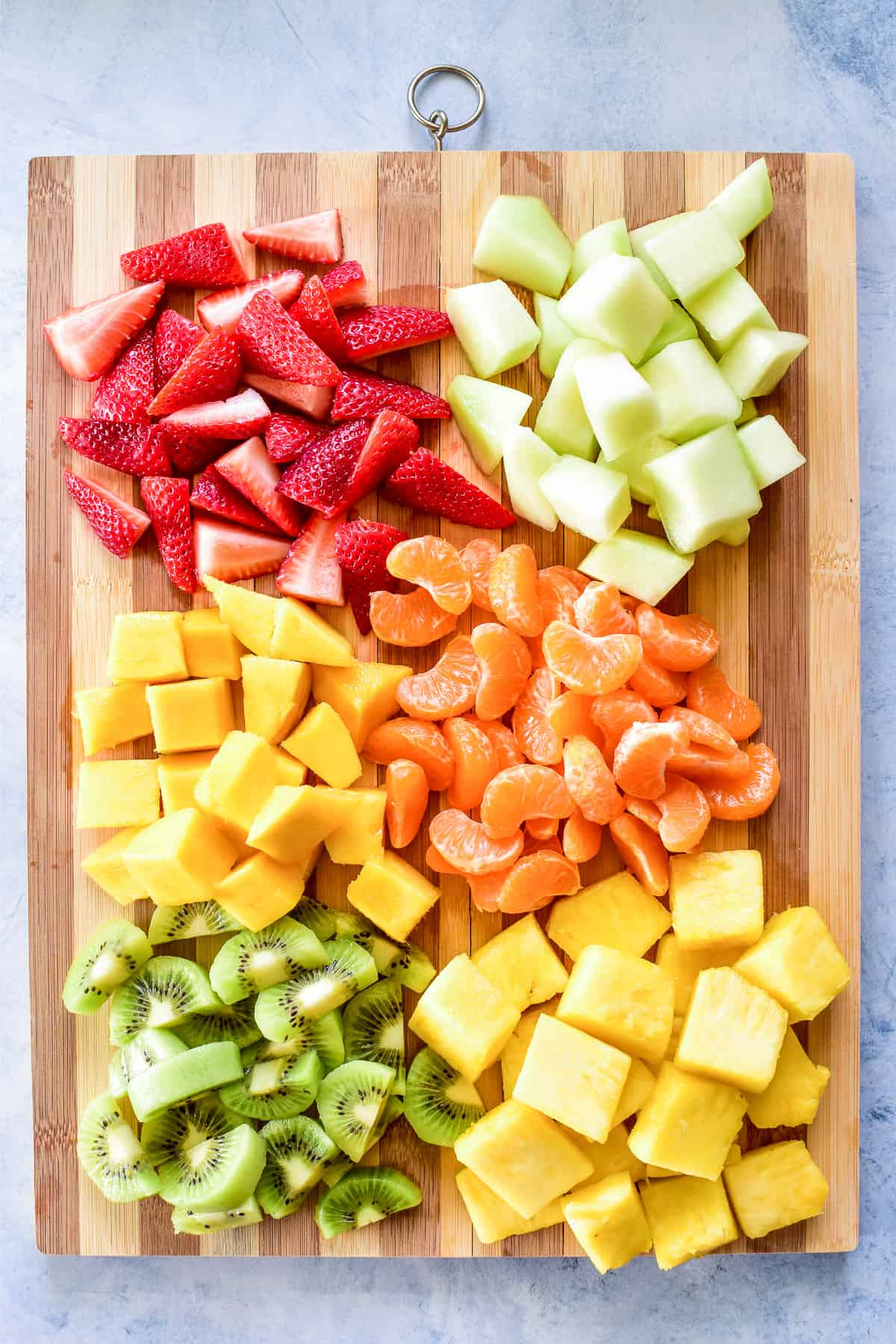 Chopped fruit on a wooden cutting board