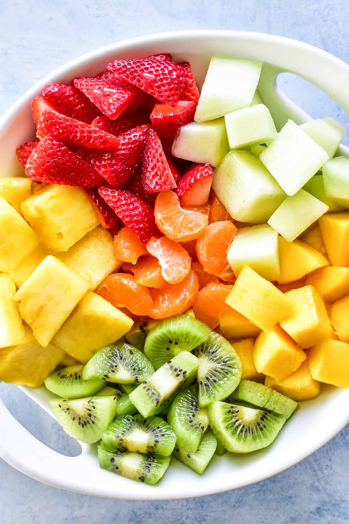 Tropical fruits in a white bowl