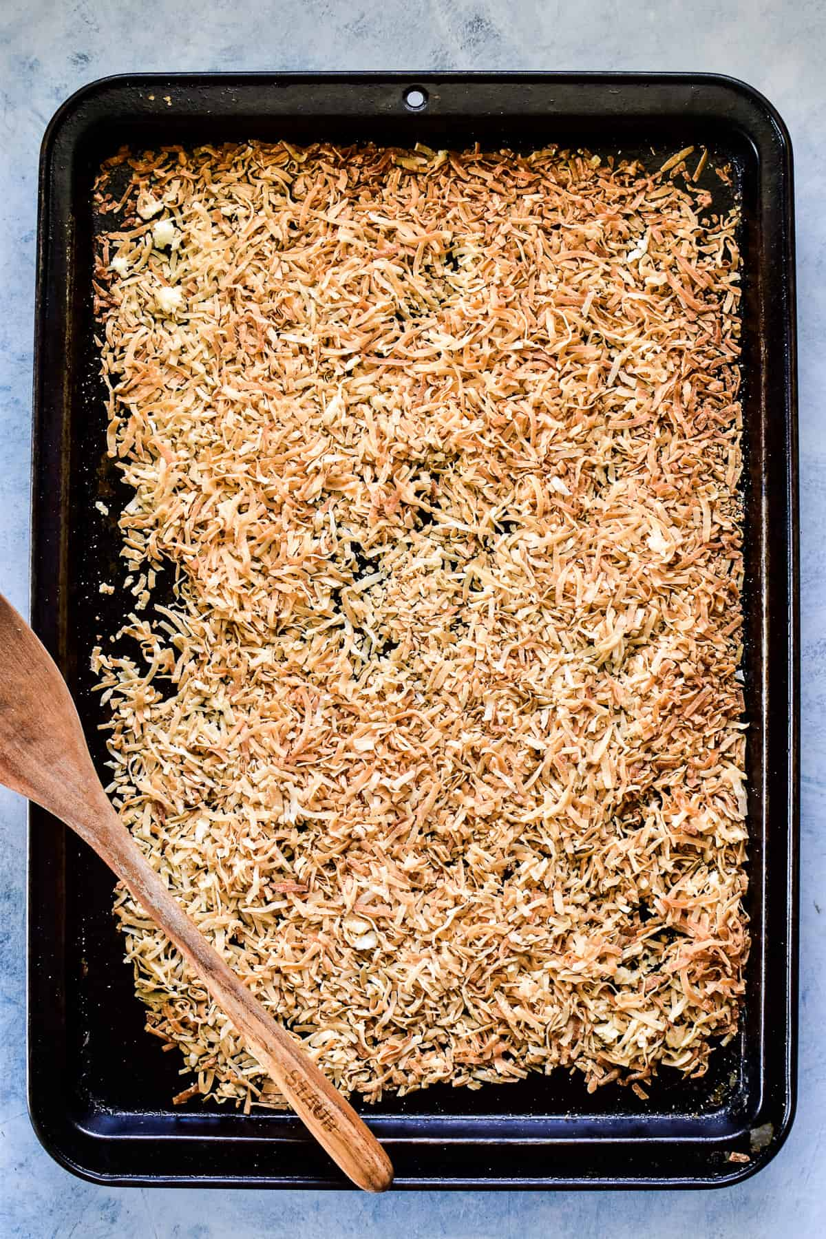 Toasted coconut on a rimmed baking sheet