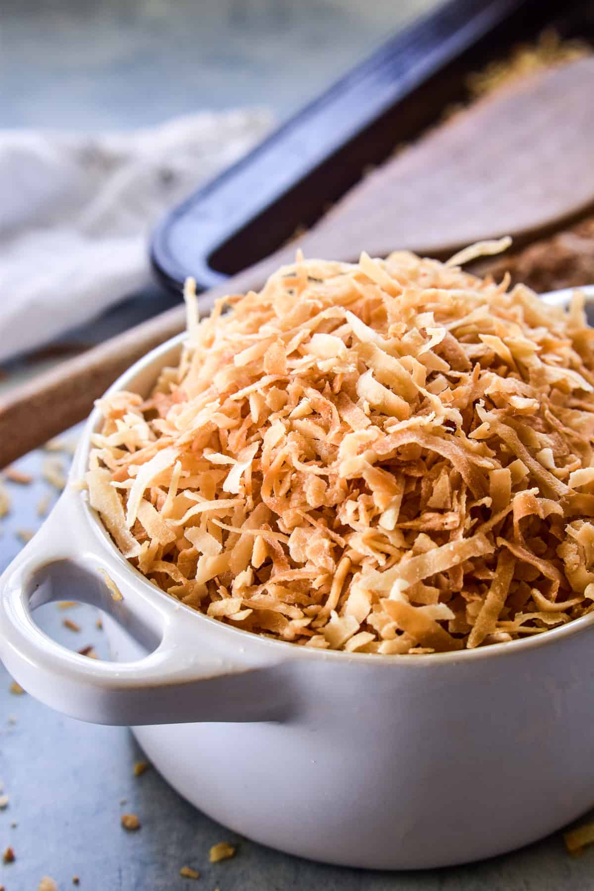Toasted Coconut in a small white bowl