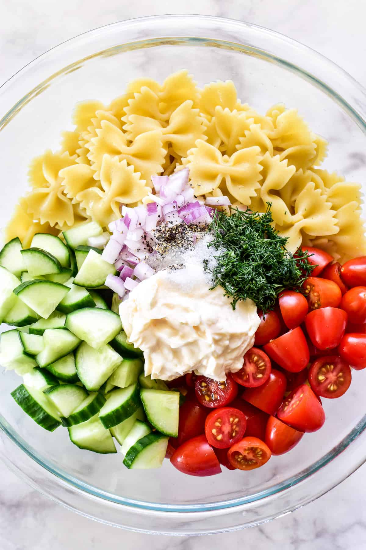 Cucumber Pasta Salad ingredients chopped in a mixing bowl