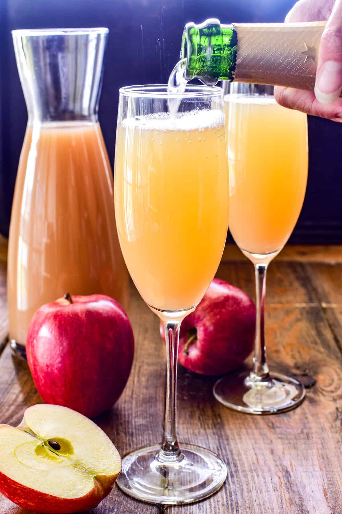 Photo of champagne being poured into an Apple Cider Mimosa