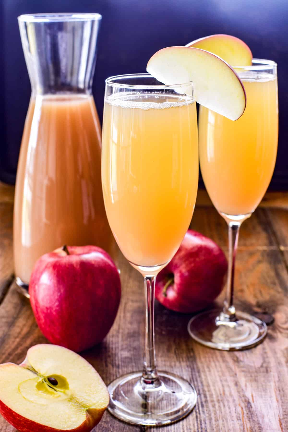 Apple Mimosa in a champagne glass with an apple garnish