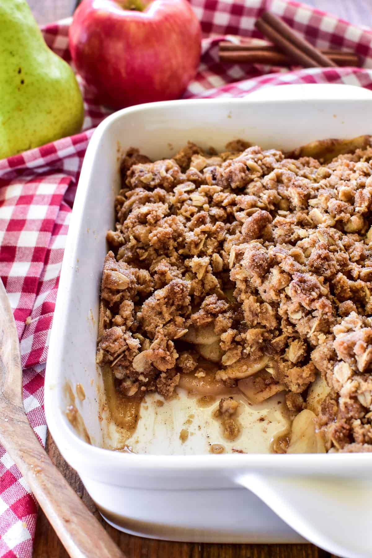 Apple Pear Crisp in an 8x8 inch white pan with a spoonful missing