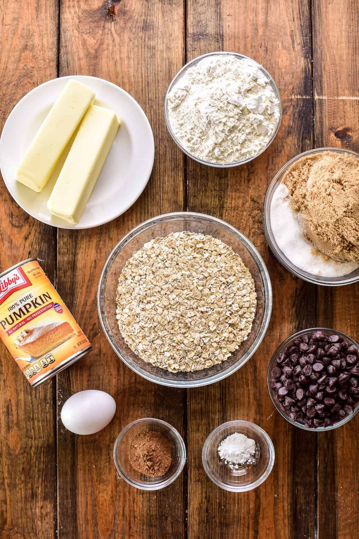 Pumpkin Oatmeal Chocolate Chip Cookie ingredients on a wooden board