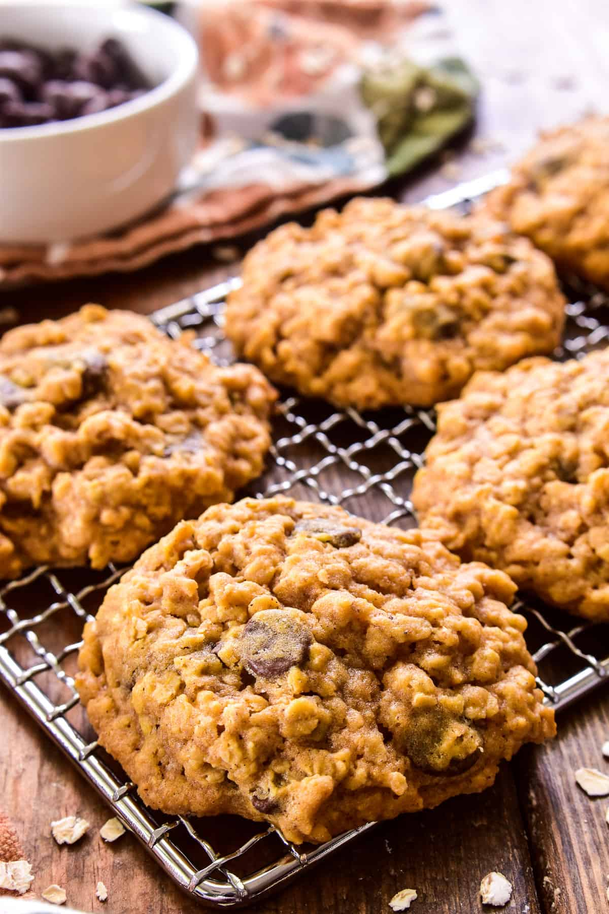 Close up of Pumpkin Oatmeal Chocolate Chip Cookies on a wire rack