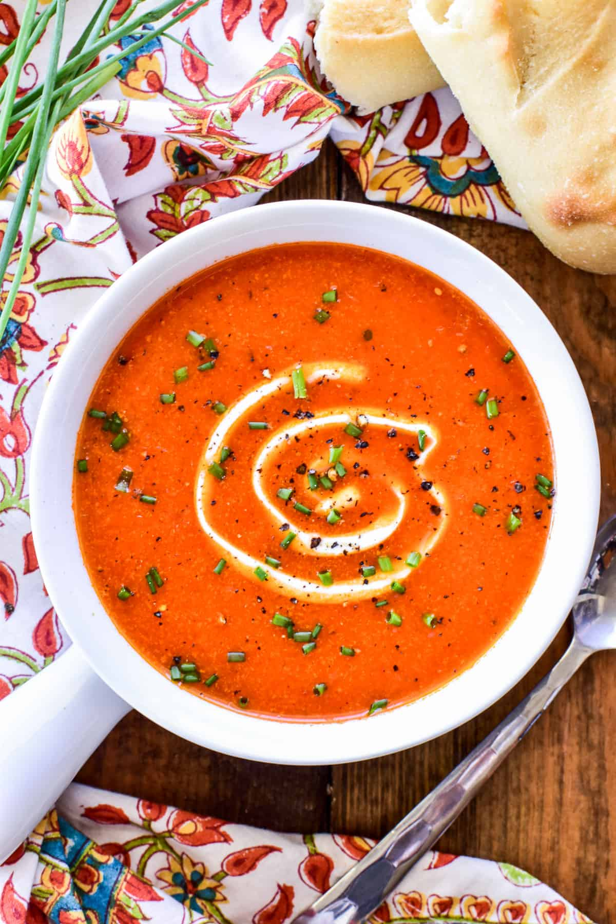 Overhead image of Roasted Red Pepper Soup with sour cream & chives
